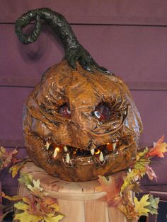 Paper Mache Pumpkin. This might be better than buying a pumpkin and carving it.