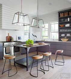 Skip the built-in island and, instead, consider embracing the industrial tone of a raw metal island that once served as a lab table, industrial work table, or cart. Although the search may take time to find the perfect fit and style for your space, that one-of-a-kind metallic character isn't easy to replicate.