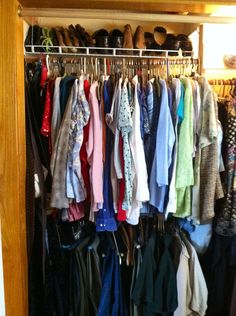 Closet hanging shoe rack; angled, hangs by 4 thick wires from high shelf above it. Maximizes space in cramped closet, and keeps shoes off the floor and easy to see and reach.