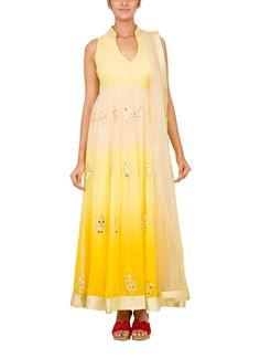 This bright and shimmering Vandana Sethi anarkali has been designed to set you apart from the crowd. The elegant anarkali with a Chinese collar is sleeveless. It is made in pleasing beige and yellow hues with ombre accents and is festooned with sequin work along the body and the cut-out back. The graduated tint and the golden border of the anarkali give it a truly festive look.