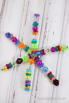Easy Christmas Ornament kids can make ~ Beaded Snowflake Ornament Holiday Crafts For Kids, Craft Projects For Kids, Christmas Gifts For Kids, Christmas Activities, Xmas Crafts, Simple Christmas, Christmas Crafts, Easy Christmas Ornaments, Snowflake Ornaments