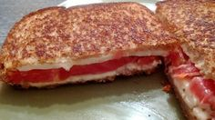 Terrific Tomato & Mozzarella Grilled Cheese Sandwich! Take 2 slices of Whole Wheat Bread, Butter the outsides of each slice. Spread 1 little triangle of Laughing Cow Mozzarella Sun Dried Tomato on 1 slice of bread. Top with enough slices of homegrown tomato & regular mozzarella cheese to cover the bread. Sprinkle a light dusting of Italian Seasoning on the Mozzarella. Top with 2nd slice of bread. Grill both buttered sides on Medium heat in a nonstick pan until browned.