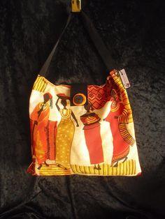 Auffallende Tasche in kräftigen Orange-Rot-und Erdtönen mit afrikanischem Motiv. oranger und schwarzer Knopf handgearbeitet,   Futter orangefarben
