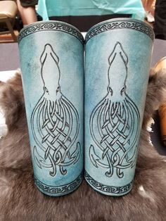 Custom leather bracers with Celtic knot squid design