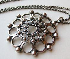 Kalevala Koru, sterling silver medallion necklace, 1985. #Finland | FinlandJewelry.com Clean Gold Jewelry, Black Gold Jewelry, Metal Jewelry, Jewelry Art, Antique Jewelry, Vintage Jewelry, Filigree Earrings, Unusual Jewelry, American Jewelry