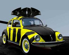 vw beetle - bumble bee, speaker on roof are to resemble small wings and the barrel of a rifle protrudes from trunk in front as a stinger!