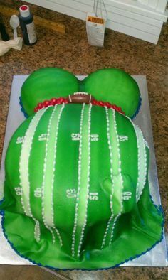 Football themed baby shower cake