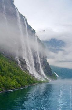 "The Seven Sisters Waterfall in Geiranger Fjord, Norway. Directly across the fjord lies a single waterfall called ""The Suitor"". The legend of the seven sisters is that they dance playfully down the mountain Lofoten, Lençóis Maranhenses National Park, Places To See, Places To Travel, Travel Destinations, Places Around The World, Around The Worlds, Beautiful World, Beautiful Places"