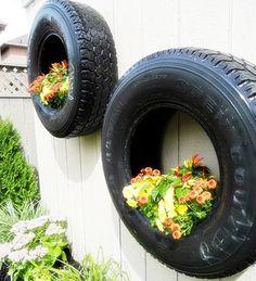 rueda de coche reciclada como macetero