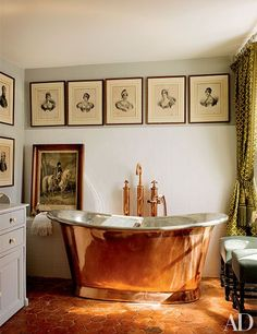 Engravings of the Bonaparte family decorate an Empire-theme guest bath.
