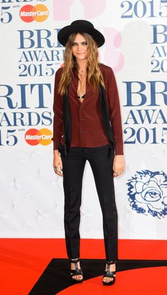 Cara Delevingne at the Brit Awards in Saint Laurent. See all of the model's best looks.