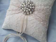 Ivory Ring Bearer Pillow Lace Ring Pillow Pearl Rhinestone Accent by Allofyou on Etsy https://www.etsy.com/listing/121029735/ivory-ring-bearer-pillow-lace-ring