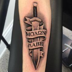 Chronic Ink Tattoo - Toronto Tattoo Custom Spartan sword and banner tattoo by Martin.