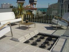 Buzon pedestals can be used with pavers, timber decking and steel grating to create raised floors.