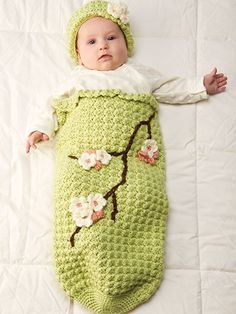 Apple Blossom Baby Cocoon & Hat Crochet Pattern Download from e-PatternsCentral.com -- This light, soft green set adorned with delicate apple blossoms makes a perfect springtime baby accessory.