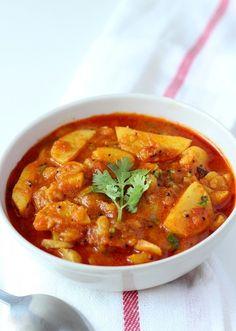 A spicy tangy Potato curry made in Gujarati style (Gujarati Rasawala Bateta nu Shaak)