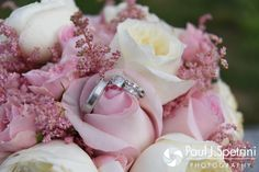 A look at Justin and Lauryn's wedding rings and Lauryn's bouquet from their July 2016 wedding reception at the Overlook at Geer Tree Farm in Griswold, Connecticut.To see more photos from Justin and Lauryn's wedding, please visit http:// www.tinyurl.com/JustinAndLauryn (Copyright 2016: Paul J. Spetrini Photography)