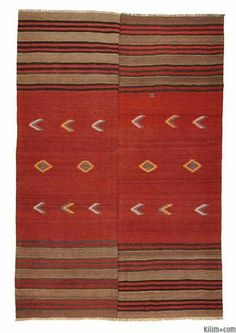 I'm getting really into the idea of a kilim rug for the living room. It'll make it feel a little more human, and bring color in so nicely.