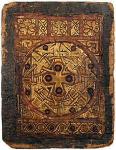 """The finest surviving Coptic bookbinding, 7th or 8th century, owned by the Morgan Library. The binding was detached from The Gospels, in Coptic, from Egypt's Monastery of Holy Mary Mother of God. """"Goatskin over papyrus boards; decorated with onlaid panels of red leather tracery sewn to a gilded leather ground, with plain edges."""""""