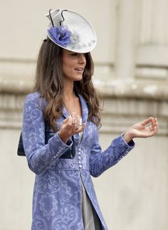 In August 2009, Kate turned heads with her fancy topper at a friend's wedding in London. We love how the purple flower appliqué perfectly matches her tapestry jacket.  - GoodHousekeeping.com