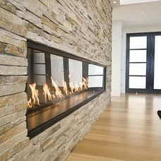 Stunning stone fireplace is the focal point in this contemporary livingroom!  www.franksglass.com