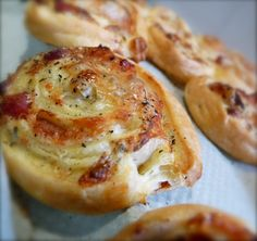 "mini appetizers using puff pastry- Ingredients:  - 1 roll of ""puff pastry""  - 1 big table-spoon of heavy cream  - 1 or 2 table-spoons of dried herbs (use fresh in the summer; Thyme, cilantro, aniseed etc.)  - 1 big fist full of grated Comté cheese (or fresh parmesan)  - Salt and pepper to taste"