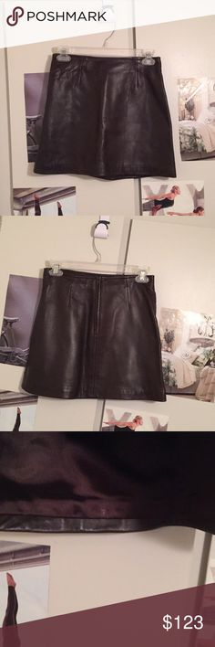 """Butter Soft Leather Brown Mini Skirt John Carlisle smooth creamy soft brown lined back zip mini skirt. 27"""" waist; 14"""" length at midline, 14.5"""" length at sides. Slight flare shape makes this skirt extremely easy to wear, and long enough to sit down in modestly 😊. Size 4 timeless vintage skirt has been stored without hangers, so there are no pinch marks on the leather. Only wear is shown in last photo. (Left & right top of skirt at side seams.) Many tops will cover this. Style w/your fave…"""
