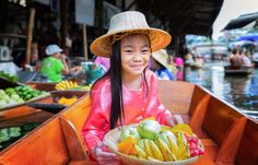 Picture of Chikd sit on the boat and hold the fruit basket in Traditional floating market , Thailand. stock photo, images and stock photography. India For Kids, Inverness Scotland, Thailand Tourism, World Travel Guide, Travel Tips, India Facts, Facts For Kids, Worldwide Travel, Scotland Travel