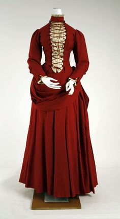 Love the richly crimson hue and unique lacing on this wonderful (1880s) Victorian dress. (Image via The Costume Institute of the Metropolitan Museum of Art). #red #Victorian #dress #fashion #gown #clothing #costume #beautiful