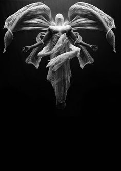 The Archangel by Christian Hopkins. ° low key black and white photography.  Religion