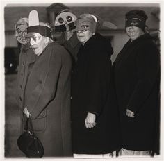 Untitled (five women in masks) by Diane Arbus