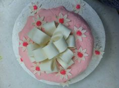 My Wilton Method Class Cakes #wiltoncontest.  Took my Wilton class at Hobbly Lobby in Kokomo, IN.  Stacey Hatfield taught the gum paste and fondant class.  Scalloped pink fondant over white and added a white fondant bow and daises with pink sugar sprinkles.