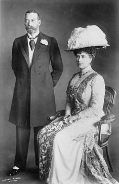 Queen Mary wearing wide hat and King George V