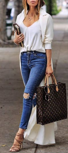 A+white+silk+top+featuring+a+pretty+chest+detail+It`ll+look+great+with+a+pair+of+jeans+or+leggings