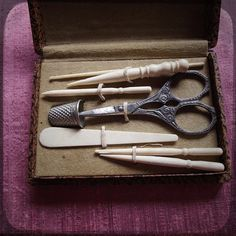 Antique French sewing kit with beautiful vintage ornate scissors, thimble and bone accessories in a case