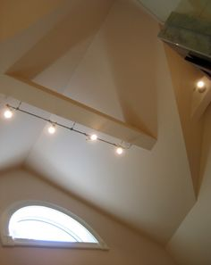 the cathedral ceiling posed the biggest challenge we incorporated a very modern track lighting system cathedral ceiling track lighting