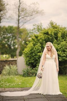 Bride wears a boho chic gown   Photography by Helen Russell.
