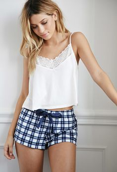 Forever 21 Plaid Flannel PJ Shorts | Navy/Cream | Nothing says classic quite like plaid and nothing translates to comfort the same as flannel does. So we decided to apply those concepts into something that you can (and probably will) wear everyday: PJ shorts! But instead of keeping them too standard (insert: boring), we added a sateen ribbon drawstring on an elasticized waist and ruffled trim. Definitely your loungewear go-to piece for timeless girly comfort.