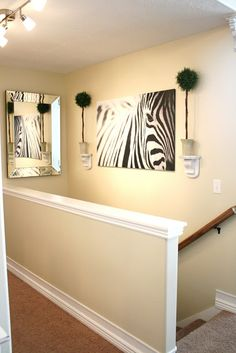 Architectural treatment of staircase half wall with custom Decorate a large wall cheaply
