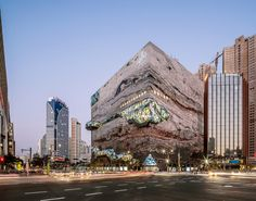 OMA wraps glass walkway around Galleria department store in Gwanggyo