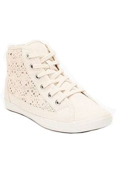 Urban Outfitters Crocheted sneakers, $39. urbanoutfitters.com.
