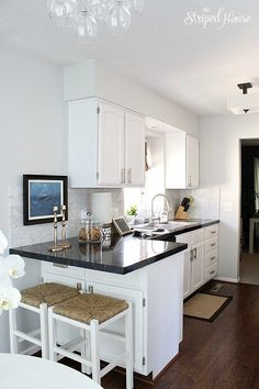 kitchen makeover | painted cabinets | black & white | classic & contemporary | wood floors & Carrera marble | DIY
