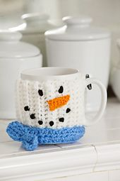 Snowman Mug Hug pattern, by Michele Wilcox on Ravelry. Free pattern! >> This would be a neat idea for a Christmas gift!