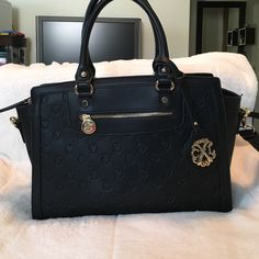 Christian Lacroix black handbag Christian Lacroix black handbag. Comes with long strap. Strap drop- 5 1/2 inches, height- 9 inches, bottom of bag- 4 1/2 - 6 inches X 13 inches, top of bag zipper line- 15 1/2 inches across Christian Lacroix Bags