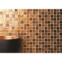 Rich metallics of bronzes and coppers work their magic in kitchens and bathrooms.