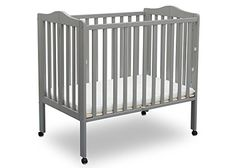 Great for small spaces or as a travel crib, the Portable Folding Crib with Mattress from Delta Children is well built and versatile. Its rolling casters allow for easy movement throughout the home, so Cheap Baby Cribs, Best Baby Cribs, Kids Store, At Home Store, Wood Crib, Baby Crib Mattress, Crib Bedding Sets, Nursery Bedding, Portable Crib