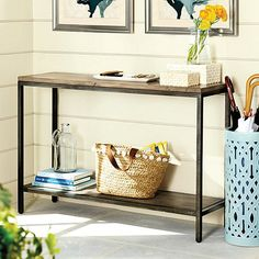The clean, architectural design of this metal frame Console Table is based on an antique bricklayer's table. Use it as a casual server in the dining room, behind a sofa or in the entry. Planked wood top is heavily distressed to bring out the natural grain and character.Durham Console Table features: Rustic Natural Wood finishAged steel metal finishCrafted of solid woodAssembly required