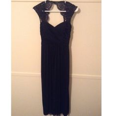 Midnight blue prom dress Only worn once and then dry cleaned, in perfect condition! While on a hanger, from the top of the shoulders to the bottom of the skirt, it is 54 inches long. Fits small/extra small. Camille Dresses Maxi
