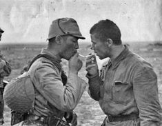 An Imperial Japanese Army infantryman lights the cigarette of a Soviet Red Army POW, captured during the battle of Khalkhin Gol, 1939