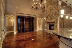 wall color, floors, and fireplace, very cool.